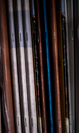 Stack of old magazines spine vertical abstract background texture