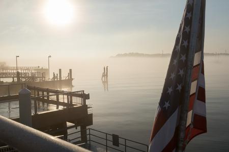 Foggy morning salem harbor pier flag mist