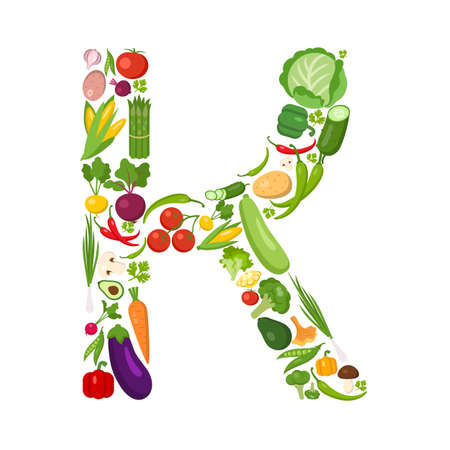 K letter from vegetables. Green alphabet. Fresh green vegetables for healthcare. Healthy diet concept. All vegetables like carrot, onion, tomato, pepper, cucumber, cabbage.