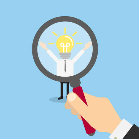 Hiring staff concept. Hand with magnifying glass finding and recruiting new worker. Man with lightbulb head.