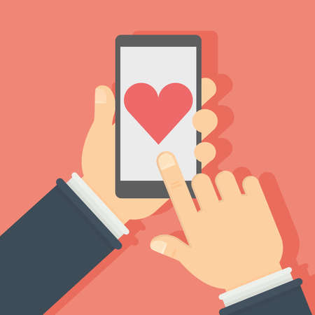heartshaped: Smartphone with like button. Hands holding smartphone with heart-shaped like button on the screen. Concept of social networks, sharing.