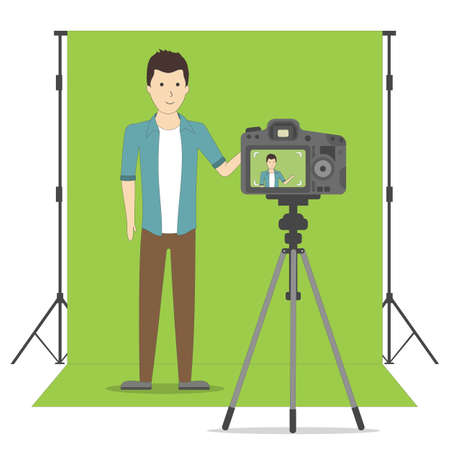 Studio blog recording on chroma key background. Vlog. Video recording. Handsome boystanding and recording himself. Social sites.