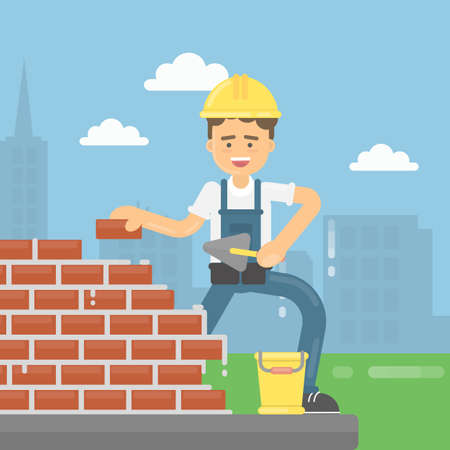Worker lays bricks. Happy bricklayer in uniform and helmet does his work. Concrete and bricks.