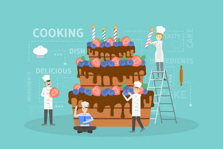 Cooking big cake. Chefs in uniform decorating cake.