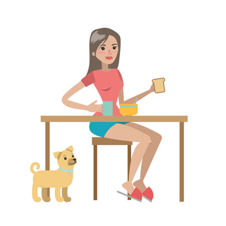Woman having breakfast with her dog