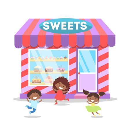 Niños corriendo frente a la tienda de dulces.
