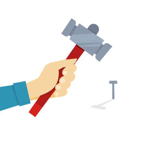 Hand holding hammer. Carpenter hammers a nail