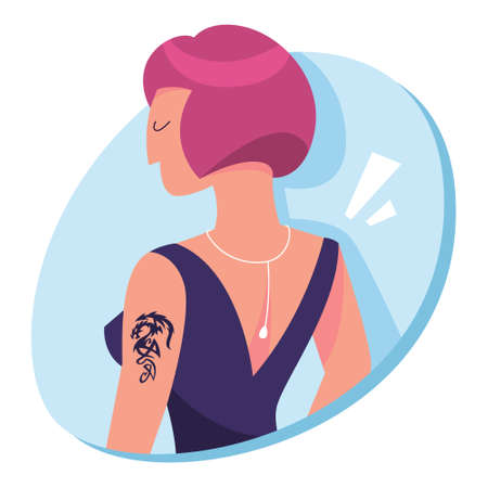 Happy woman with tattoo on the shoulder