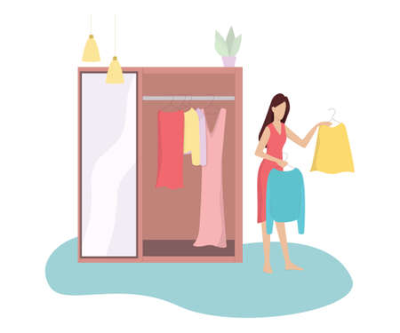 Young woman choosing between two clothes. Girl in doubt