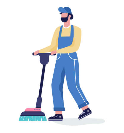 Man in the uniform cleaning floor using vacuum cleaner.