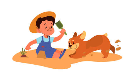 Little boy play with his dog. Happy kid and pet spend time together