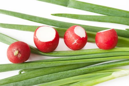 green onions over white background with red radish Stock Photo - 6978651