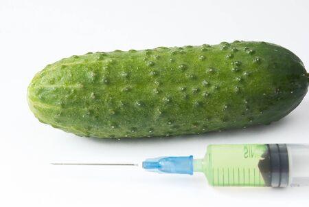 cucumber and syringe. genetic modification food Stock Photo - 7258186