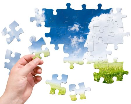 puzzle in hand on landscape background Stock Photo
