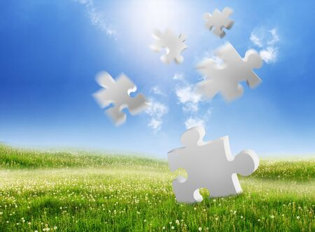 falling puzzle pieces on a green landscape Stock Photo - 7978746