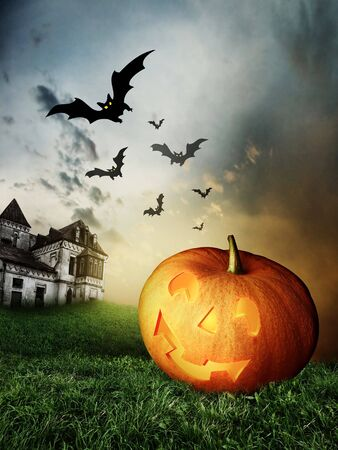 halloween Pumpkins and haunted house photo