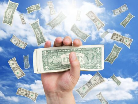 hand with dollar and falling money Stock Photo - 7978751