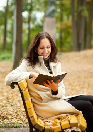 smilling: pretty woman reading book and smilling