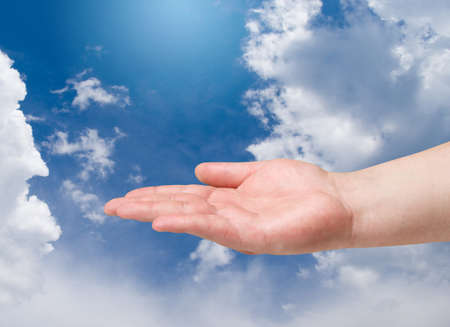 poverty relief: Man hand on blue sky background