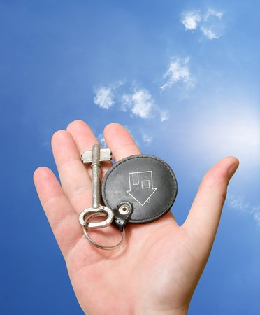 vintage keychain in human hand over white Stock Photo - 8035383
