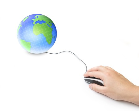 hand and computer mouse with earth globe isolated background   photo