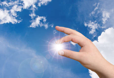 hand holding the sun Stock Photo - 8035380