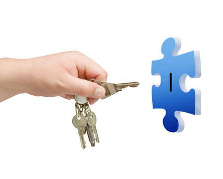key in hand with puzzle isolated background photo