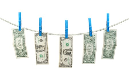 US Dollars Hanging on Rope with Clothespins isolated background