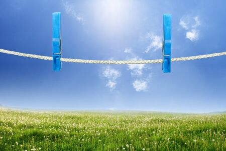 declare: clothespin on a clothesline over landscape Stock Photo