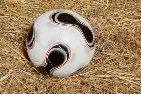 futball: futball and straw. rural sport theme Stock Photo