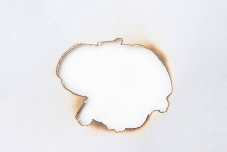 Burned paper hole photo