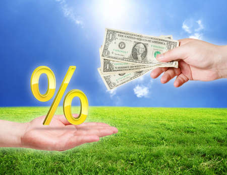 Banking concept. Money and percentage symbol in hands  photo