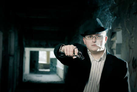 stilish: stilish man with gun and cigarette Stock Photo