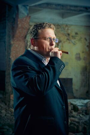 man in black suite in abandoned house. gangster boss theme photo