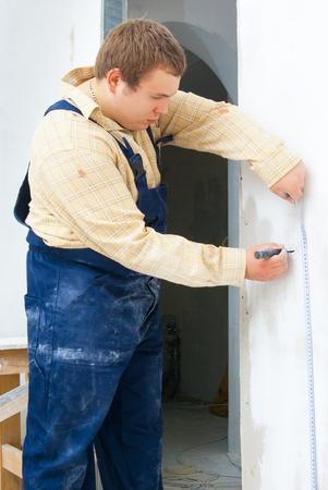measurement tape: worker using measurement tape