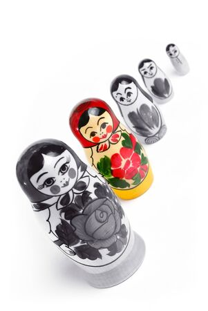 Matrioshka doll stand out from the crowd. individuality concept photo
