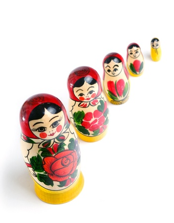 Matrioshka doll stand in the crowd over white background Stock Photo