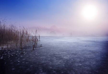 Frozen lake in winter. Fantasy scenery landscape photo