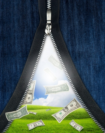unzipped: Falling money from unzipped jeans. Luck concept theme Stock Photo