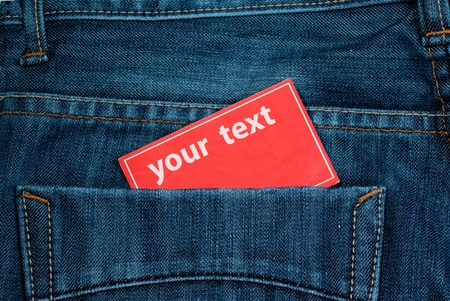 paper note in jeans back pocket with copy space