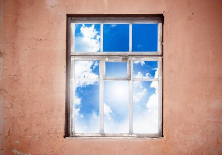 Closed window with cloud landscape photo