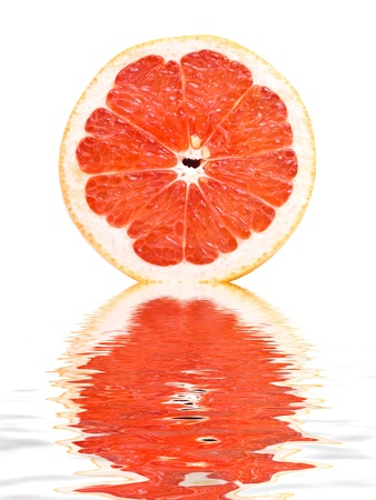 Fresh grapefruit reflecting in water