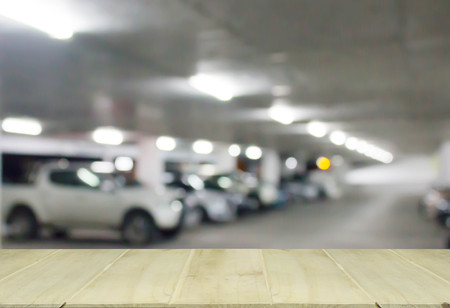 public market sign: soft focus wooden table with blur cars parking Stock Photo