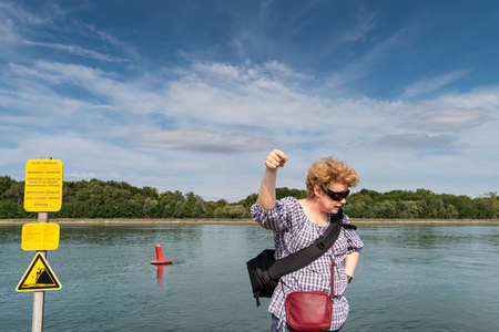 Woman explains safety on the river