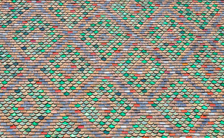 Texture, pattern, ornament from old colorful weathered roof tiles 免版税图像