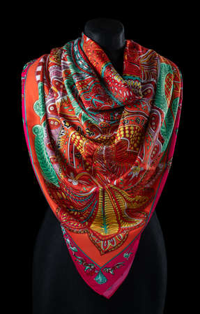 Colorful cloth, scarf on dress form against black background 版權商用圖片