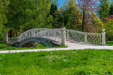White decorative bridge over a stream in Baden-Baden