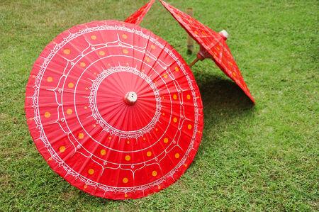 Red Handmade Painted Umbrellas on Yard in ChiangMai, Thailand Stock Photo