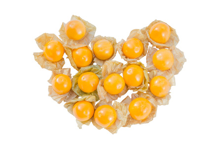 Close-up fresh pichuberry (Cape Gooseberry), very delicious and healthy berry fruit, uchuva isolated on white background grouping like heart shape, flat lay, top view angle