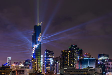 BANGKOK, Thailand - August 29, 2016: The Night of Lights with MahaNakhon Rising for grand opening show of the building. Mahanakhon is an officially Bangkoks tallest building in Thailand, close to BTS